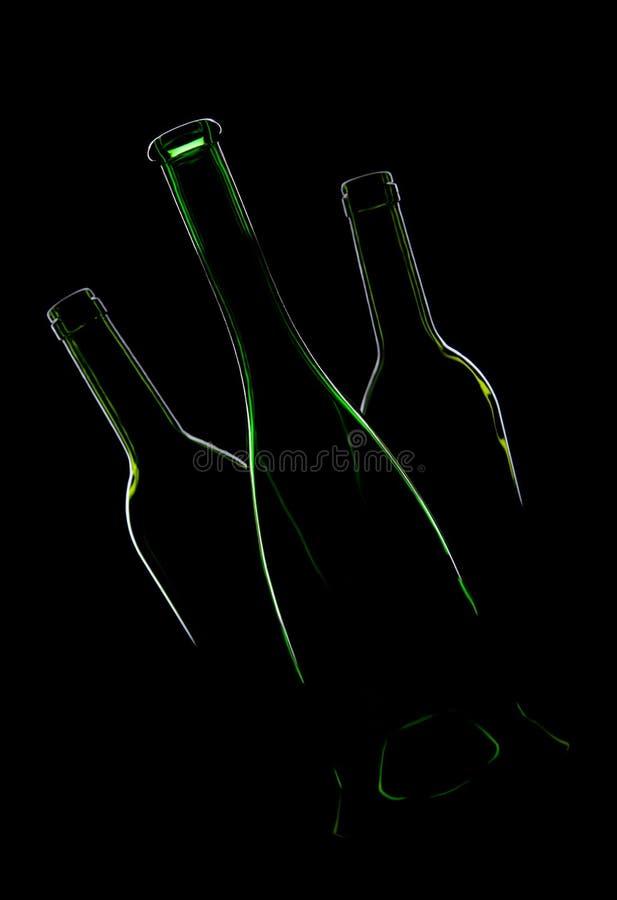 Tre bottiglie verdi vuote fotografia stock libera da diritti
