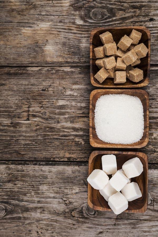 Tre bunkar av socker royaltyfri foto