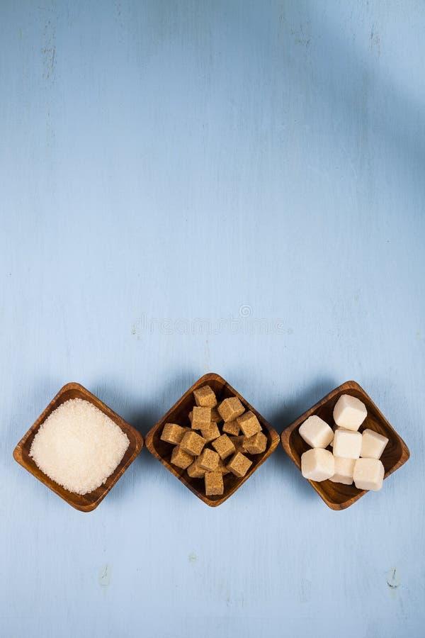 Tre bunkar av socker, bästa sikt royaltyfri foto