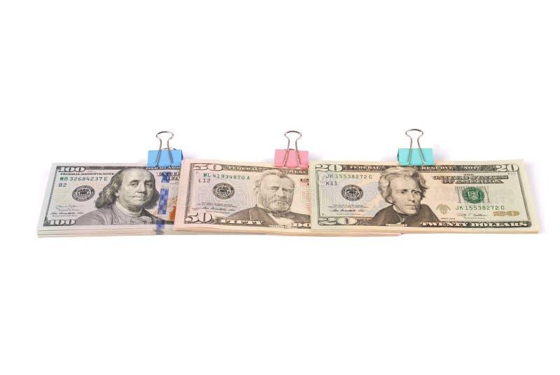 Tre buntar av pengar hundra femtio och tjugo dollar arkivfoton