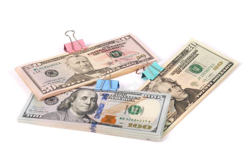 Tre buntar av pengar hundra femtio och tjugo dollar royaltyfri fotografi
