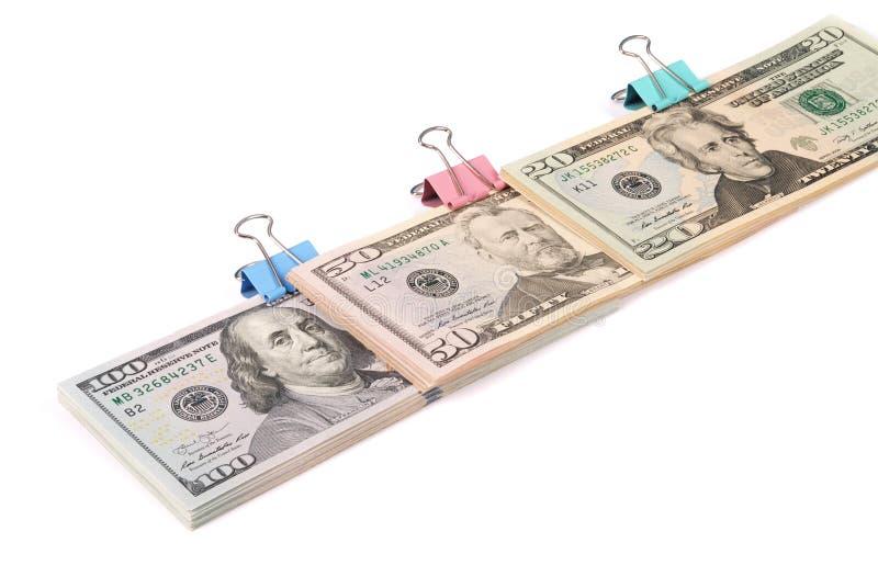 Tre buntar av pengar hundra femtio och tjugo dollar royaltyfri bild