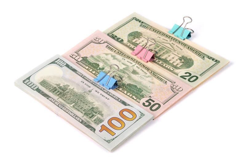 Tre buntar av pengar hundra femtio och tjugo dollar royaltyfria bilder
