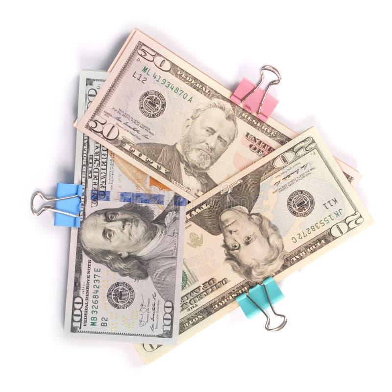 Tre buntar av pengar hundra femtio och tjugo dollar royaltyfri foto