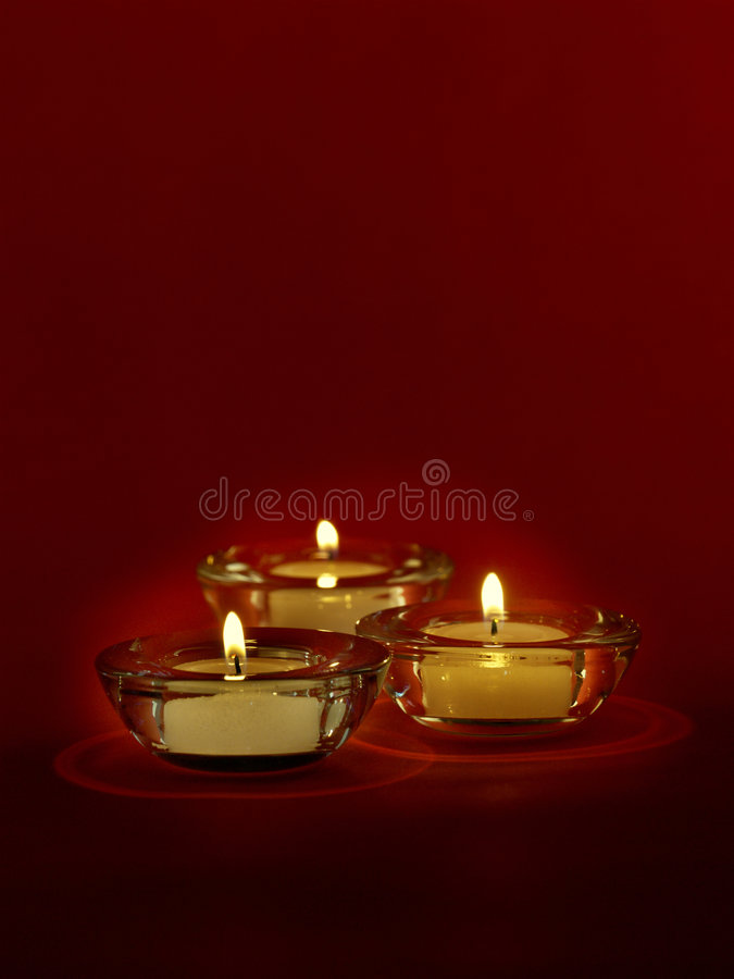 Tre candele immagine stock