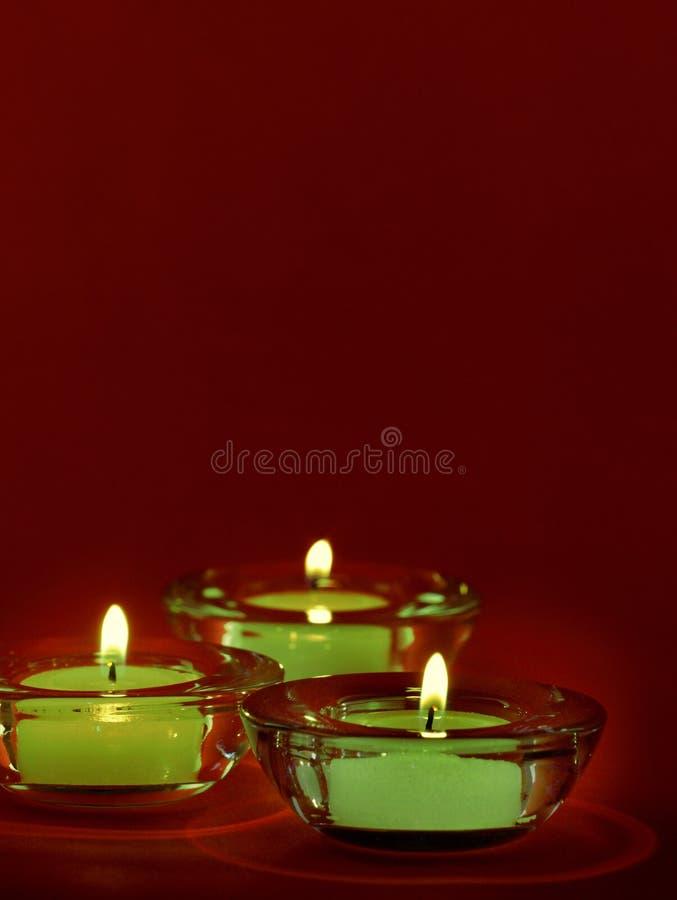 Tre candele fotografie stock