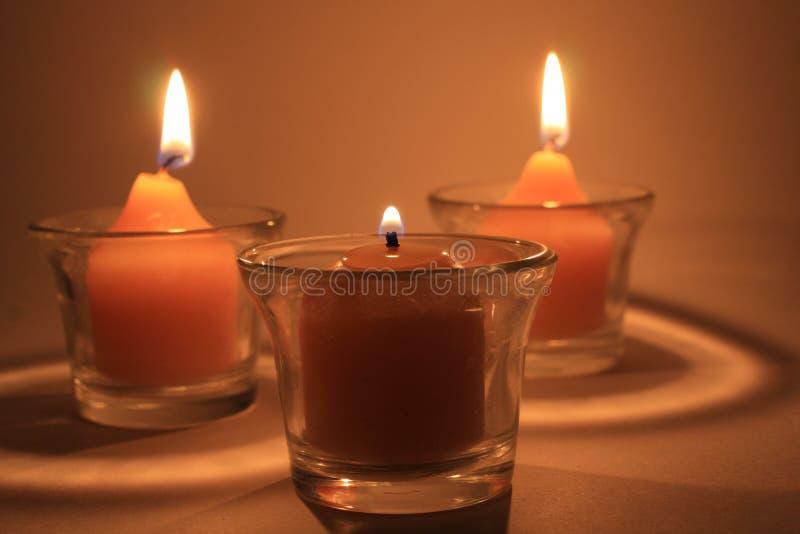Download Tre candele seppellenti fotografia stock. Immagine di distensione - 7316782