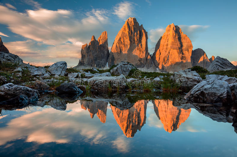 Tre Cime di Lavaredo with reflection in lake at sundown, Dolomites Alps royalty free stock image
