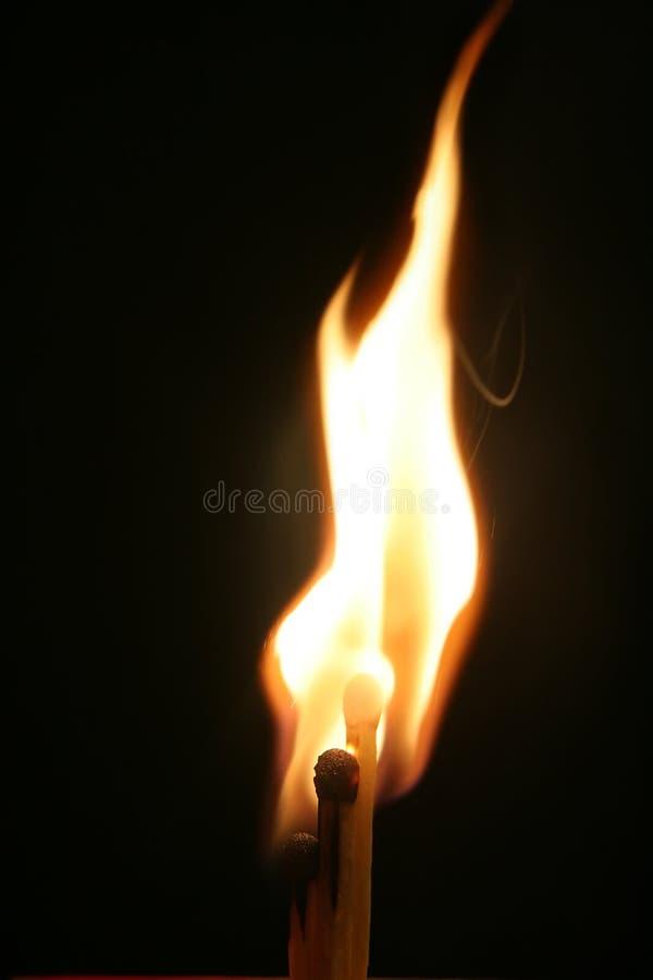 Tre corrispondenze bruciate appena fotografia stock