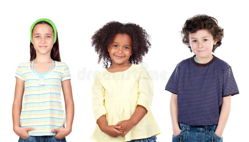 Tre diferentsbarn fotografering för bildbyråer