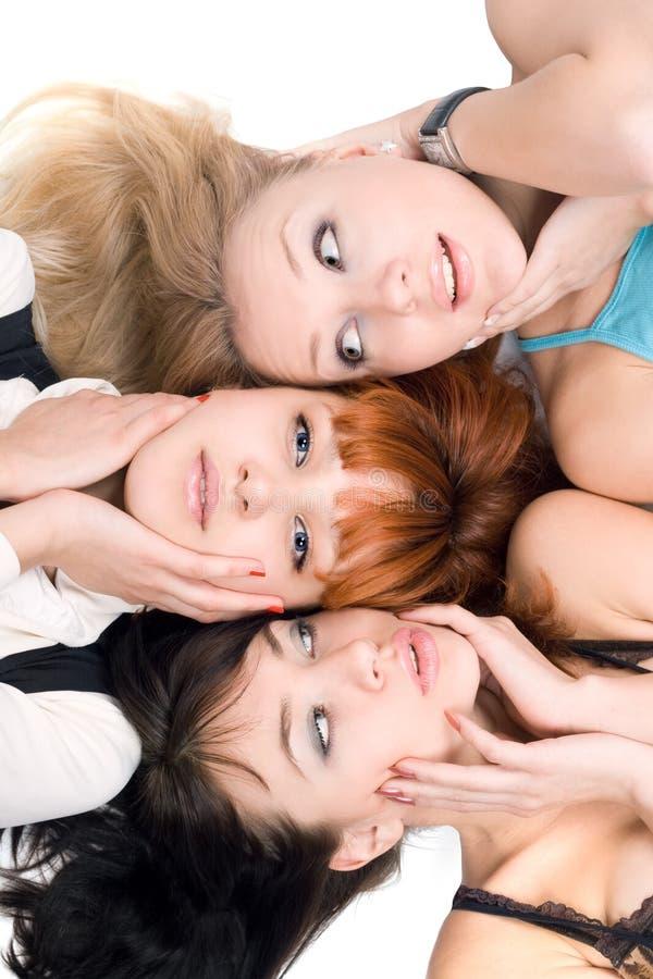 Tre donne di disturbo che toccano le loro guancie fotografia stock