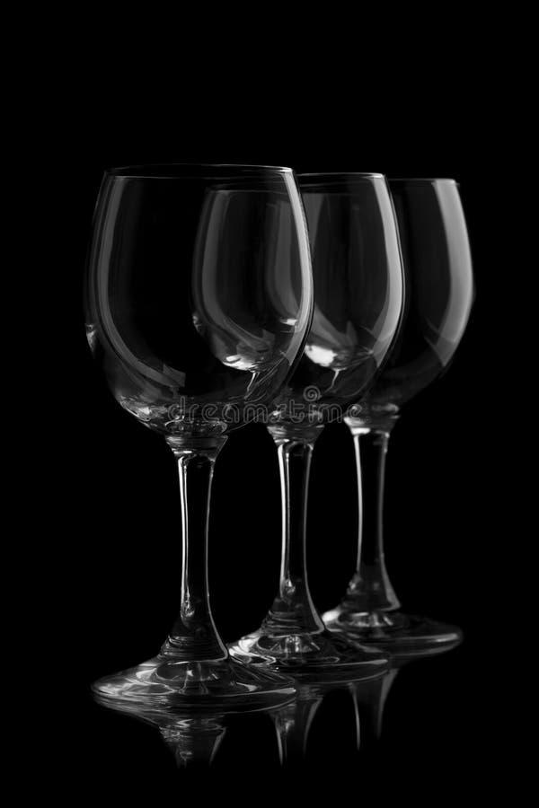 Tre eleganta vinexponeringsglas royaltyfri fotografi