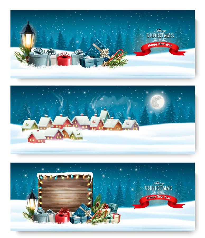 Tre feriejulbaner med en vinterby stock illustrationer