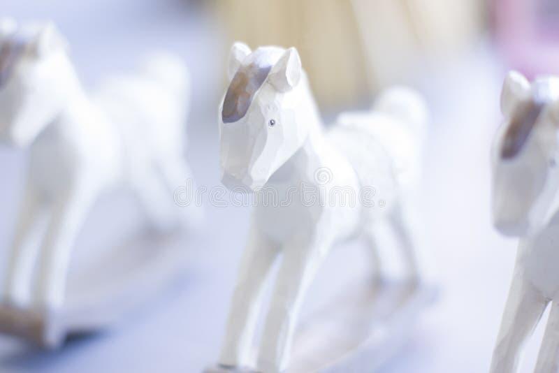 Tre figurine dei cavalli fotografia stock