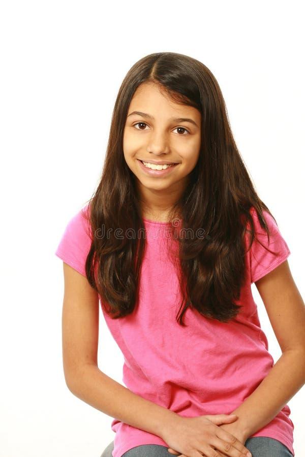 Tre fjärdedel som skjutas av att le för flicka för östlig indier fotografering för bildbyråer
