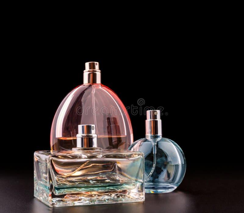 Tre flaskor av dofter fotografering för bildbyråer