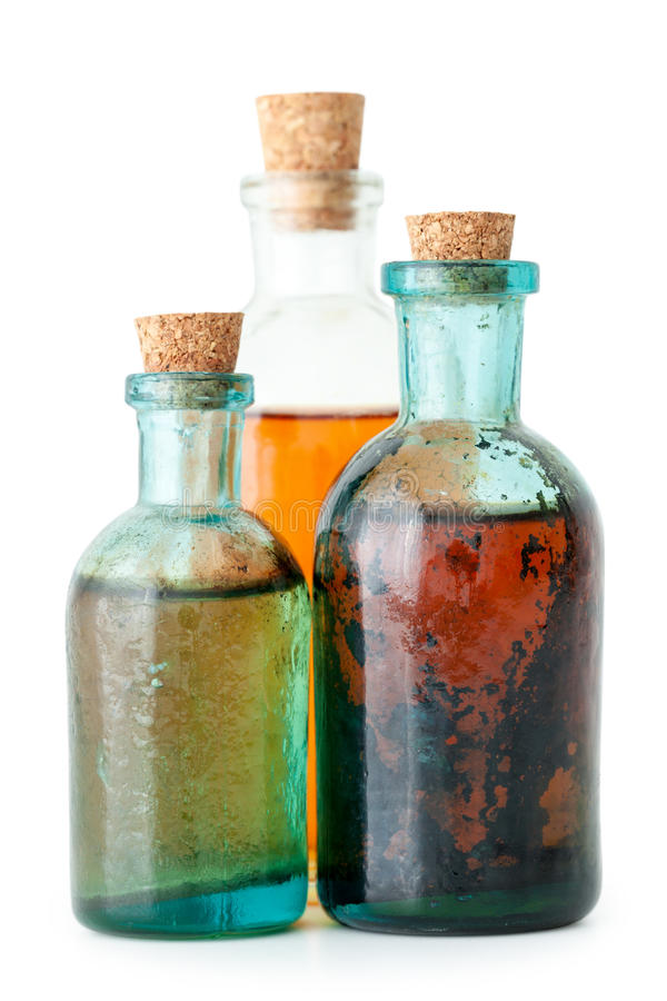 Tre flaskor av växt- avkok eller nödvändig olja royaltyfria bilder