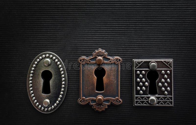 Tre gamla lås arkivbild