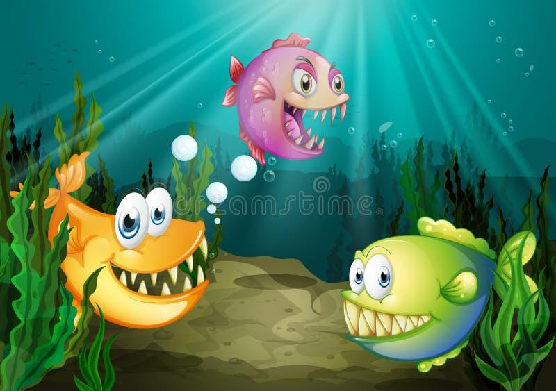 Tre generi differenti di pesci con le grandi zanne sotto il mare royalty illustrazione gratis