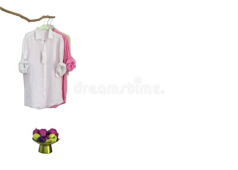 Tre hängda skjortor royaltyfria foton