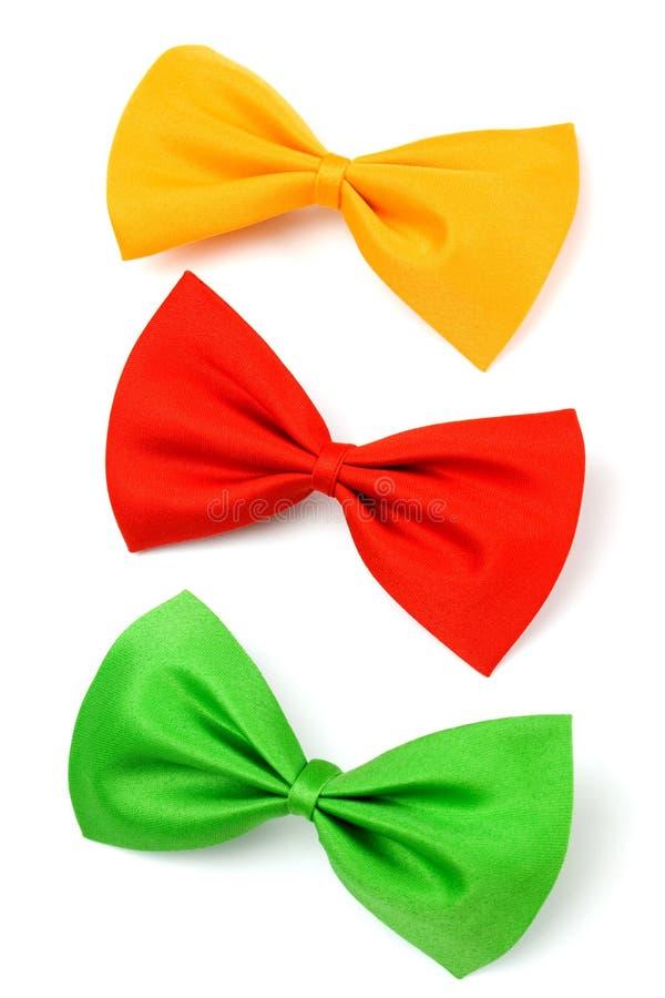 Tre hanno colorato i legami di arco isolati su bianco fotografie stock libere da diritti