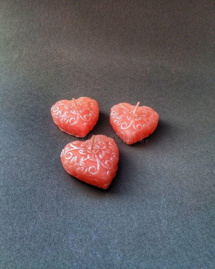Tre hjärtastearinljus arkivfoton