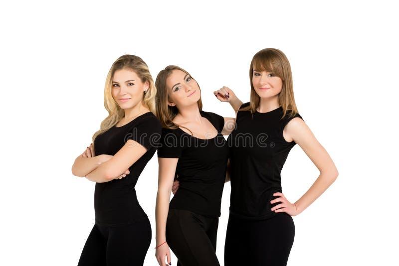 Tre isolerade kvinnor bantar och idrotts- royaltyfri bild