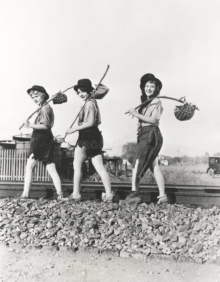 Tre kvinnliga luffare arkivbild