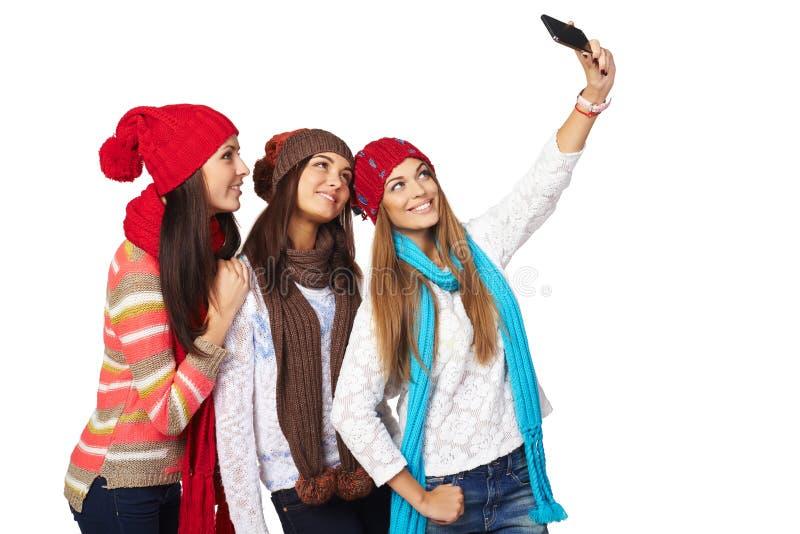 Tre kvinnor som gör selfie royaltyfria foton