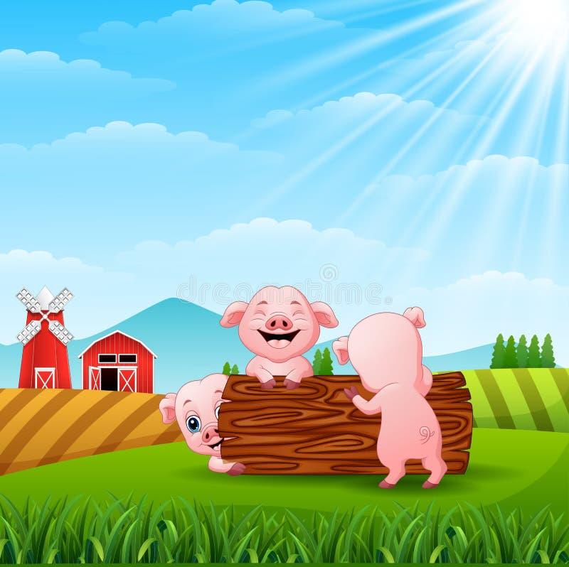 Tre lilla svin som spelar journaler på kullar royaltyfri illustrationer