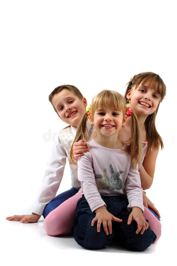 Tre lyckliga ungar royaltyfria bilder