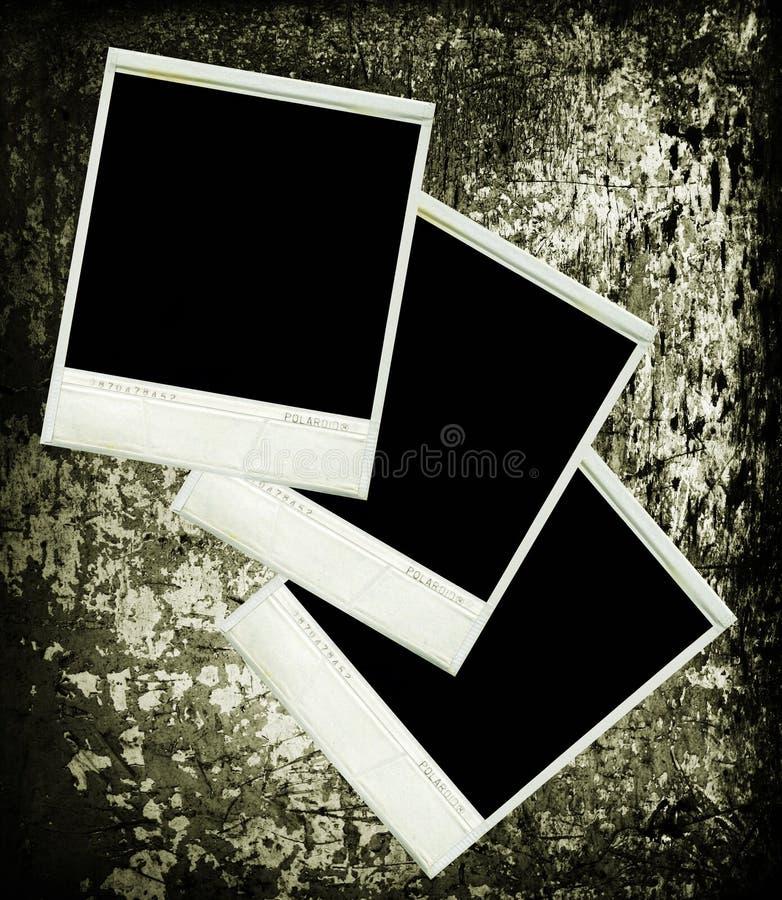Tre maschere dell'annata del polaroid su struttura di legno immagine stock libera da diritti