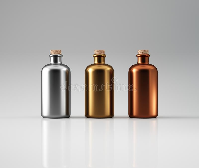 Tre metalliska flaskor royaltyfri bild
