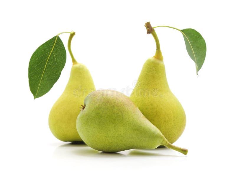 Tre mogna pears arkivfoton