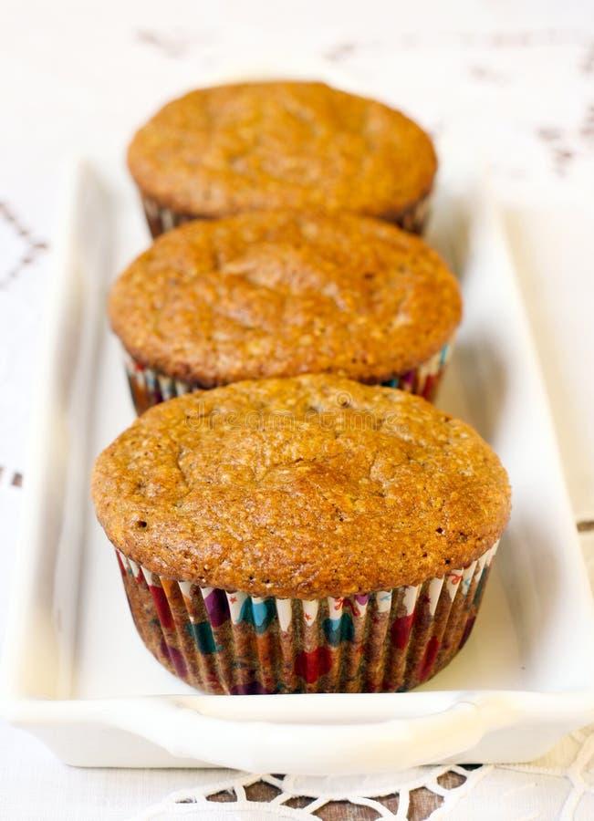Tre muffin della zucca immagine stock