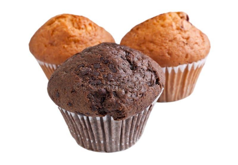 Tre muffin su fondo bianco fotografia stock libera da diritti