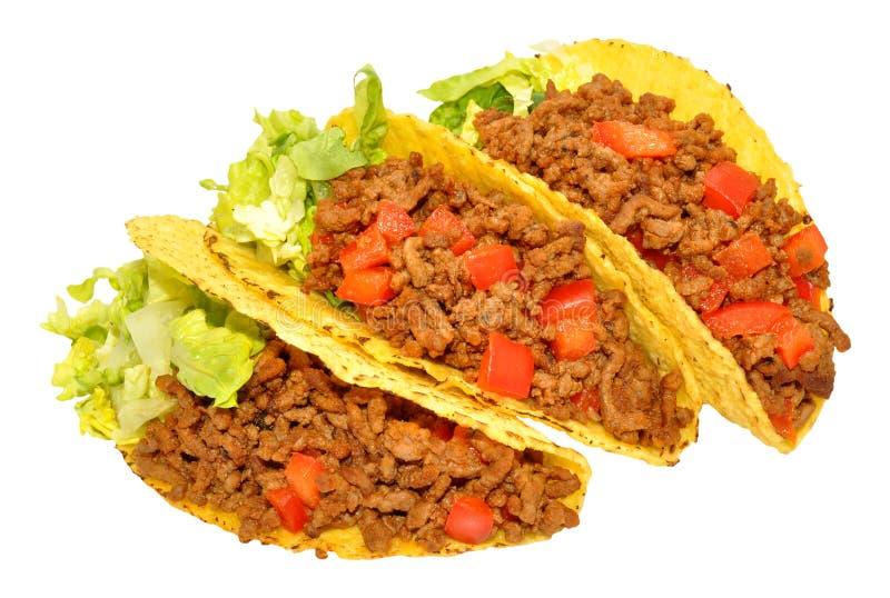 Tre nötkött fyllda taco arkivfoton