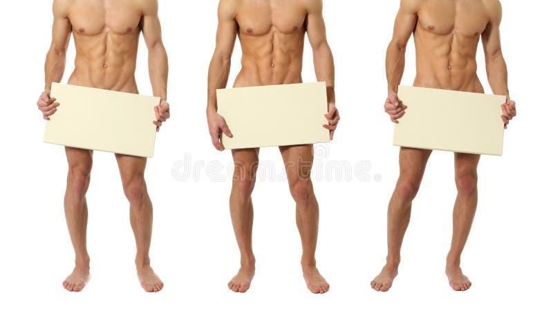 Tre nakna män som täcker med ett tomt tecken arkivfoto