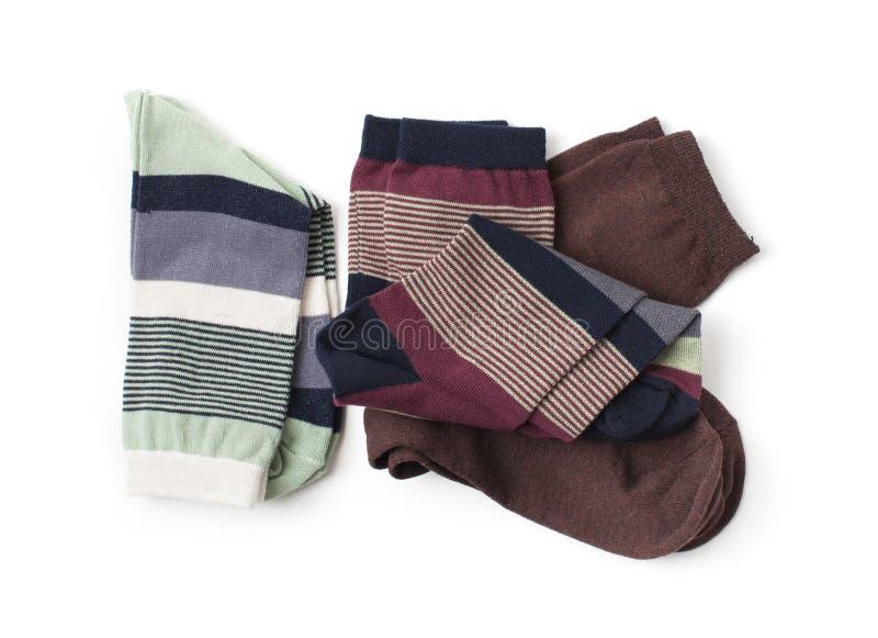 Tre paia dei calzini su un fondo bianco immagini stock