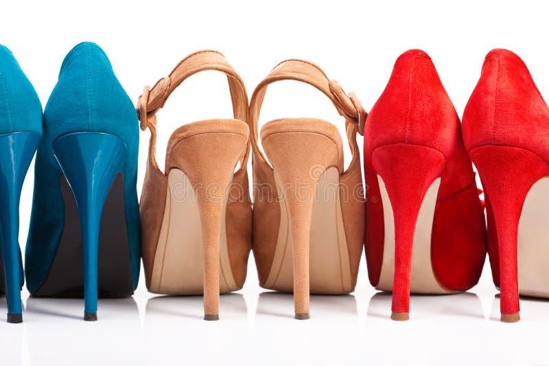 Tre paia delle scarpe delle donne con fotografia stock libera da diritti