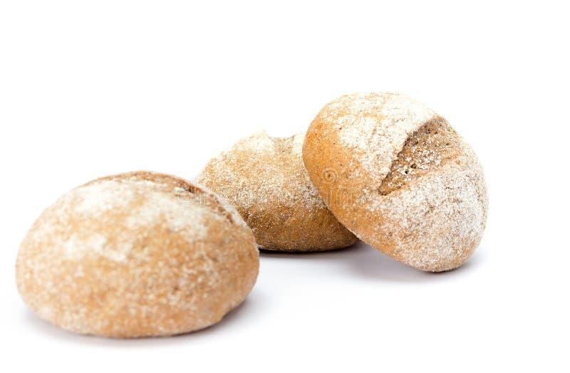 Tre panini spruzzati con farina fotografie stock libere da diritti