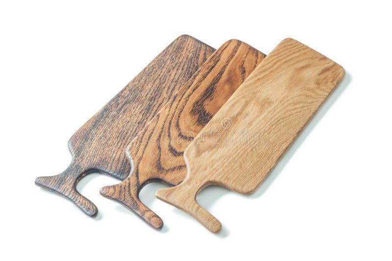 Tre pannelli di legno di quercia isolati in bianco fotografia stock