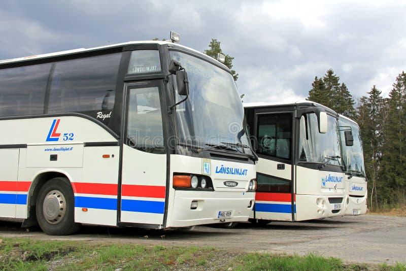 Tre parkerade bussar royaltyfri fotografi