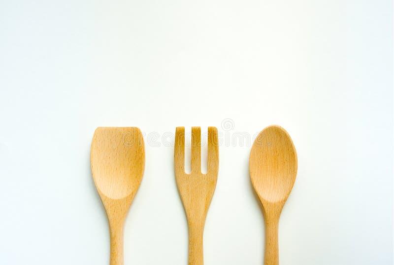 Tre pezzi di Turner di legno, di forchetta di legno e di cucchiaio di legno Insieme dell'attrezzatura della cucina fotografia stock