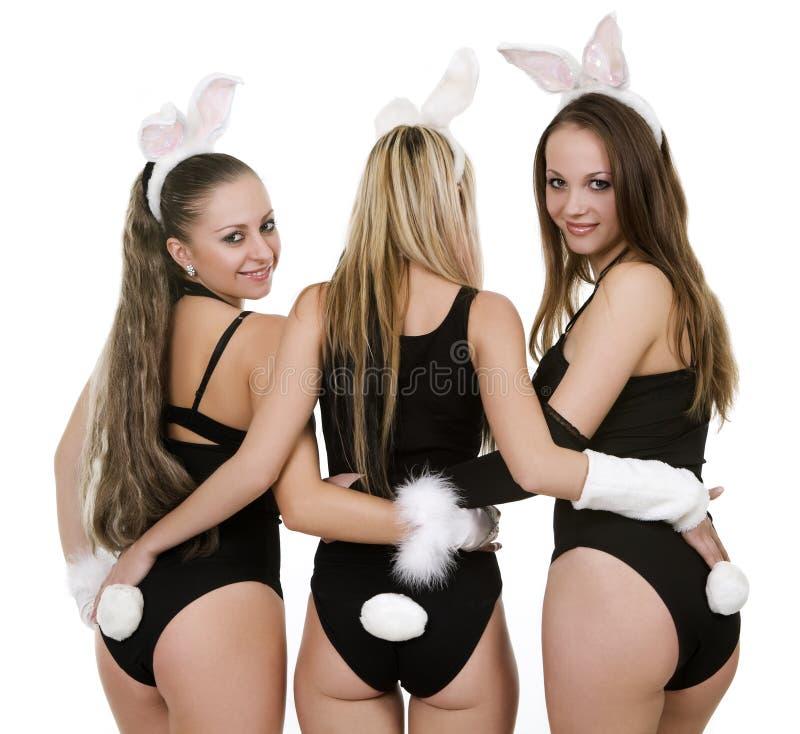 Tre playgirls in costumi del coniglietto fotografia stock libera da diritti
