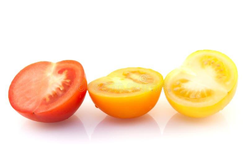 Tre pomodori variopinti fotografia stock