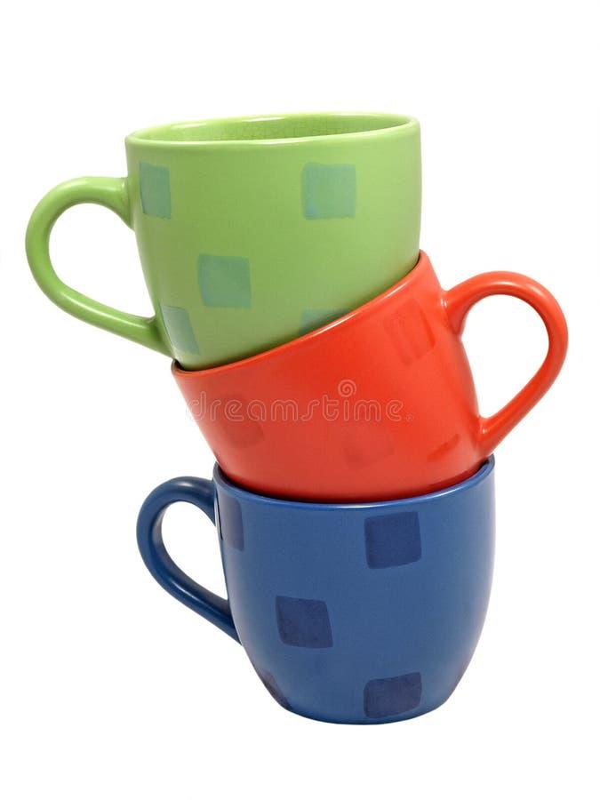 Tre protezioni del tè di colore. immagini stock