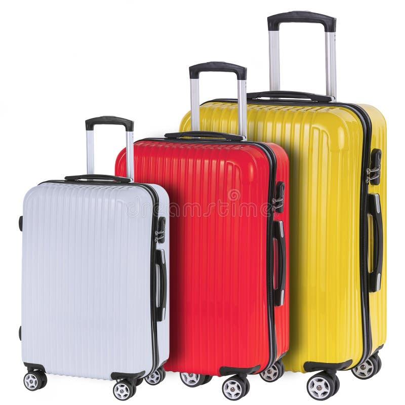 Tre röda resväskor, vit och guling royaltyfria bilder