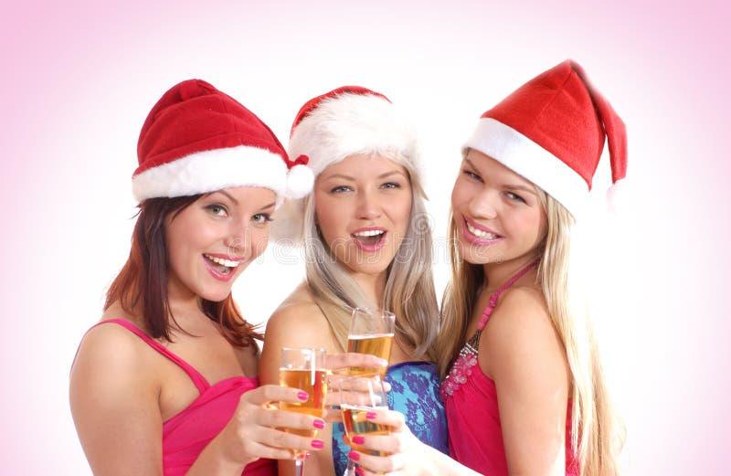 Tre ragazze stanno celebrando il natale immagini stock