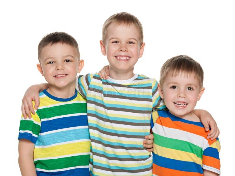 Tre ragazzi allegri di modo immagini stock libere da diritti